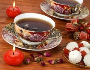 2518020-cups-of-tea-with-rose-herbal--red-candles